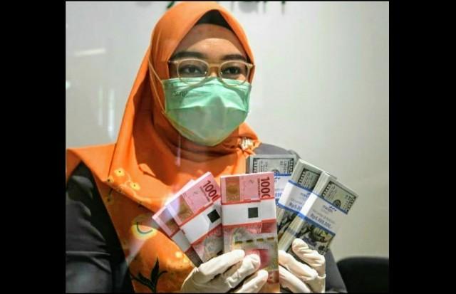 Rupiah Ditutup Menguat ke Level Rp14.657/US$