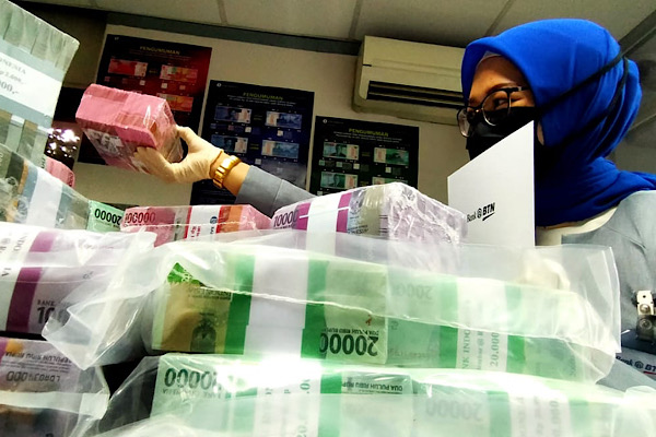 Penarikan Uang Tunai saat Lebaran Capai Rp154,5 Triliun